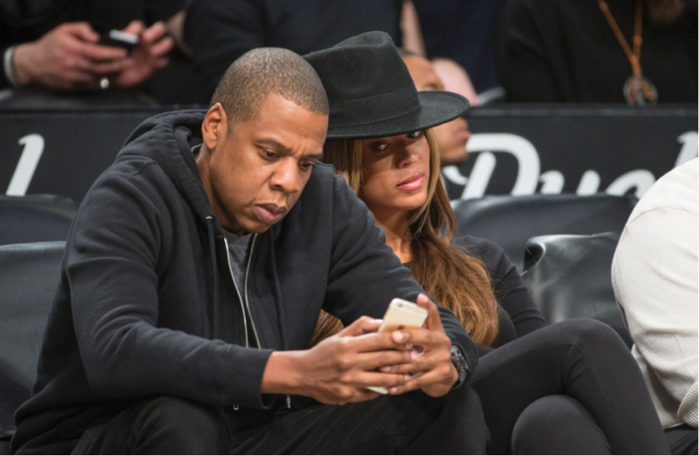 http://i1.mirror.co.uk/incoming/article4982521.ece/ALTERNATES/s1227b/Jay-Z-and-his-wife-Beyonce-sit-courtside-during-the-Brooklyn-Nets-vs-the-Houston-Rockets-2015.jpg